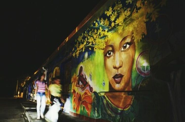 Street art Blurred Motion Adult Night People Adults Only Only Women Beauty Illuminated Beautiful Woman One Person Young Adult One Woman Only City Outdoors Art Is Everywhere Nightphotography Night Lights Night Photography Mural Painting Mural Art Muralart Mural Paintings ArtWork Artphotography Art