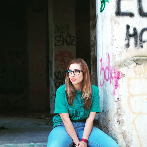 Graffiti Eyeglasses  Adult One Person Long Hair People Looking At Camera Only Women One Woman Only Architecture Outdoors City The Street Photographer - 2017 EyeEm Awards