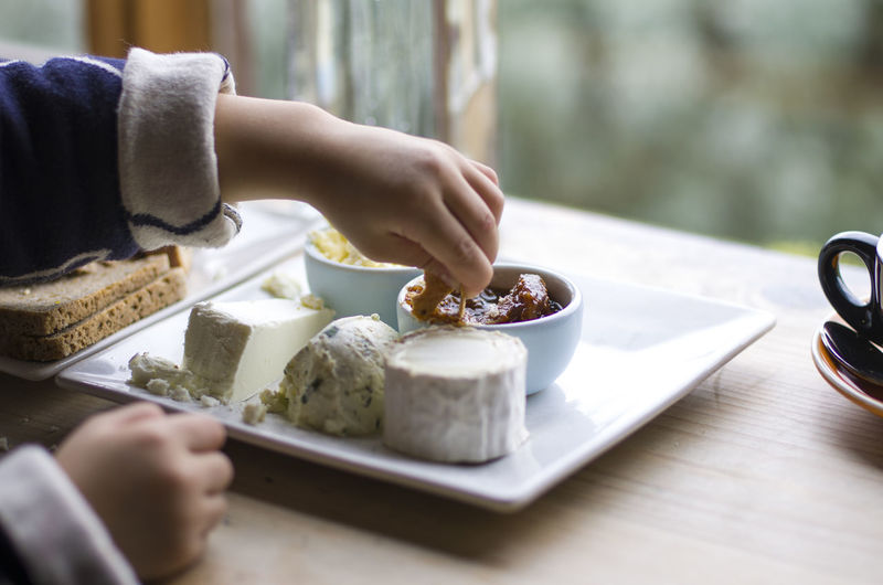 Kid loves cheese plate Child Eating Healthy Food Food Food Childhands Cheese Plate Close-up Sweet Food Food And Drink