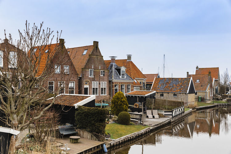Townscape with residential buildings and canal in Hindeloopen, Netherlands. Architecture Cityscape Fishing Village Hindeloopen Home Netherlands Old Town Row House TOWNSCAPE Tradition Building Exterior Built Structure Canal Canals Friesland Front Or Back Yard House No People Old Buildings Residential Building Residential District Town Canal Village Water Waterfront The Architect - 2018 EyeEm Awards