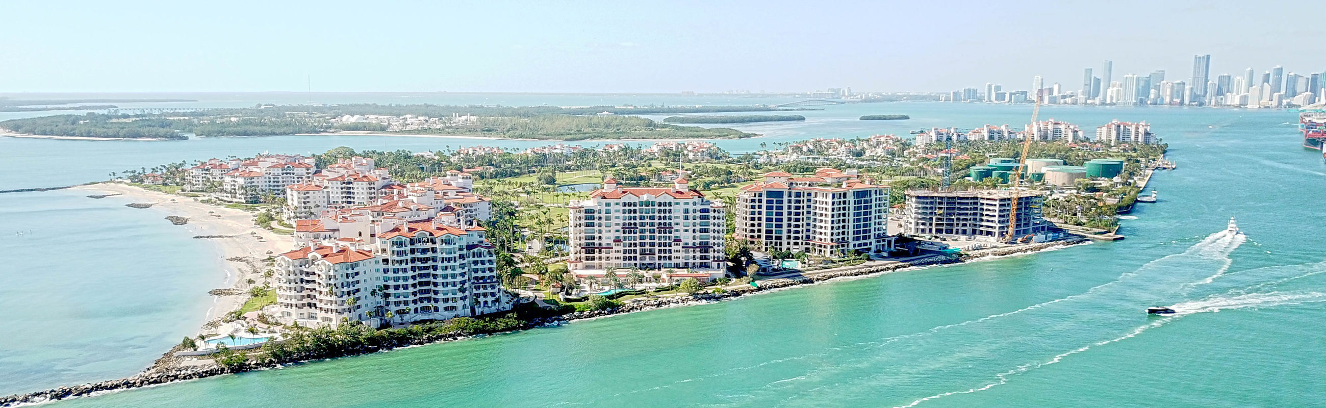 water, building exterior, architecture, sea, built structure, city, sky, building, nature, waterfront, day, high angle view, transportation, cityscape, beach, no people, nautical vessel, travel destinations, office building exterior, skyscraper, outdoors