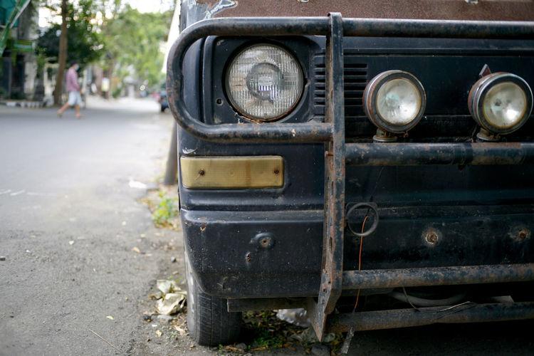 Close-up of old vintage car on street