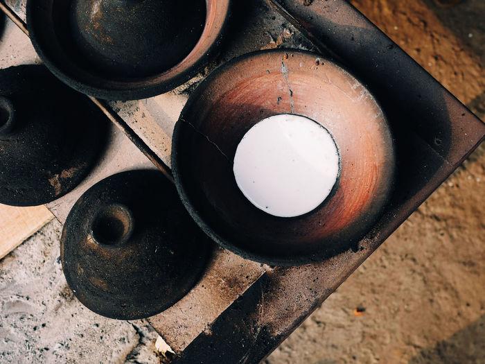 High angle view of surabi cooked upon small earthenware frying pan