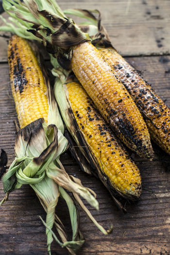 Agriculture Cereal Plant Close-up Corn Corn On The Cob Food Food And Drink Freshness Healthy Eating High Angle View No People Outdoors Raw Food Still Life Sweetcorn Table Vegetable Vegetarian Food Wellbeing Wood - Material Yellow