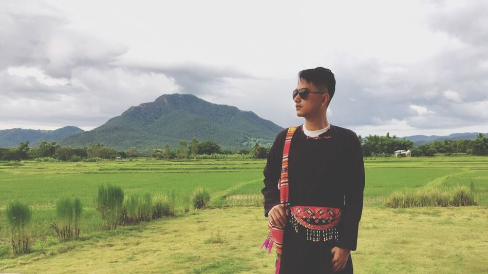 Thai-Dam Costume Field Real People Mountain Landscape Sky Young Adult One Person Cloud - Sky Nature Standing Green Color Outdoors Grass Lifestyles Day Scenics Tree Beauty In Nature People