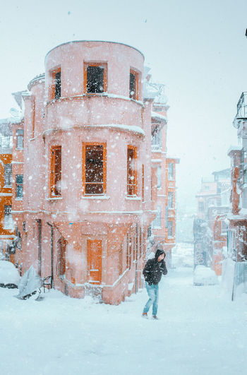 View of snow covered buildings in city