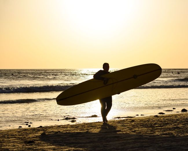 Surfer-Surfing USA Califiornia Surferboy  San Diego Surfer Water Sky Sea Sunset Beach Land Horizon Over Water Silhouette Beauty In Nature Scenics - Nature Lifestyles Nature Leisure Activity Outdoors Orange Color Men Real People