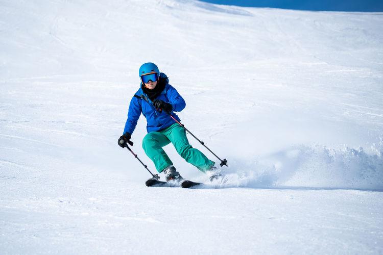 Full length of child on snowcapped mountain