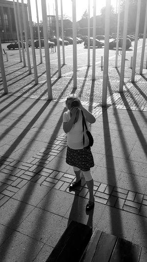 The Portraitist - 2017 EyeEm Awards Portrait Of A Woman PortraitThe Street Photographer - 2017 EyeEm Awards EyeEm Best Shots EyeEm Gallery Berlin Photography Black And White Photography Black/white Outdoors Sunlight Shadow Messe Berlin Phtographer Against The Light Noir Et Blanc Black And White Woman Berlin, Germany  Bnwphotography Flag Pole Fahnenmast Sommergefühle Discover Berlin Black And White Friday EyeEm Ready