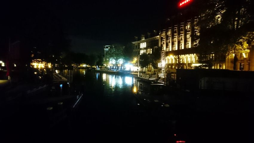 Amsterdam at night. Amsterdam The Netherlands Netherlands Holland Night Darkness darkness and light Reflections City View  Cityscape Urban Landscape City Illuminated Water Nightlife Arts Culture And Entertainment Cityscape Reflection Sky Architecture Building Exterior