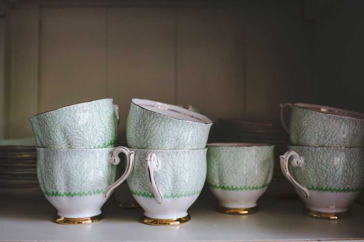 Stack of Teacups In Shelf At Home