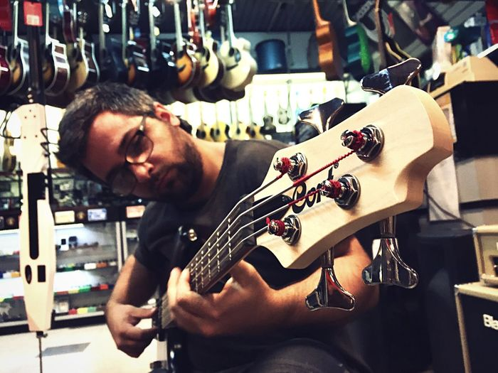 Bass man Musician Music Play Music Bajo Electrico Bass Guitar Bass Working Workshop Indoors  One Man Only Real People Skill  One Person Occupation Men Only Men Standing Industry Day Beard Guitar Repair Shop Adult Adults Only People