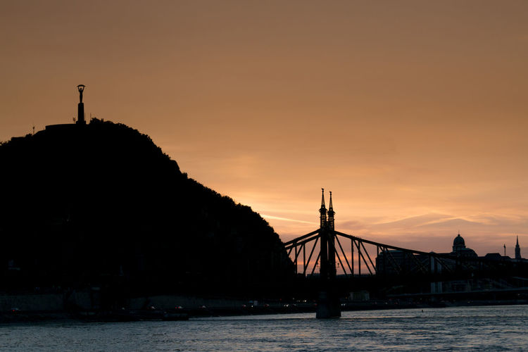 Silhouette of Liberty Statue in Budapest Architecture Beauty In Nature Bridge - Man Made Structure Budapest Budapest, Hungary Built Structure Chain Bridge Danube River Day Eastern Europe Europe Hungary Liberty Statue Budapest Nature No People Orange Color Outdoors Scenics Silhouette Sky Sunset Travel Travel Destinations Travel Photography Water First Eyeem Photo