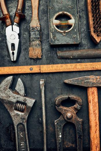 Full frame shot of rusty metal on wood