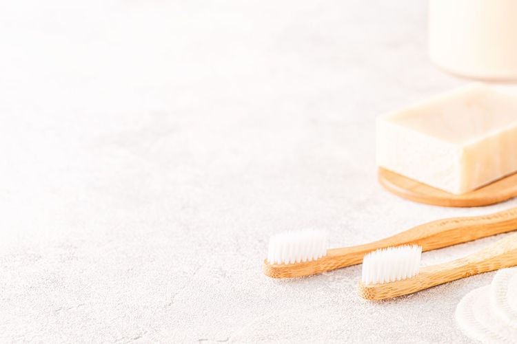 Close-up of toothbrushes with soap bar on table