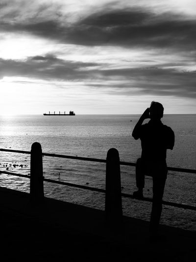 Beach Beauty In Nature Blackandwhite Cloud - Sky Day Full Length Gesturing Horizon Over Water Leisure Activity Lifestyles Men Nature Nautical Vessel One Person Outdoors Photographing Photography Themes Real People Scenics Sea Silhouette Sky Standing Sunset Water