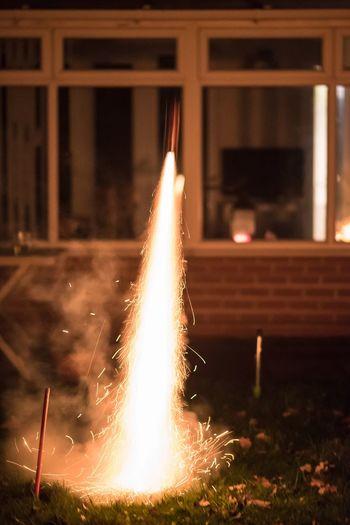 Close-up of illuminated fireworks at night