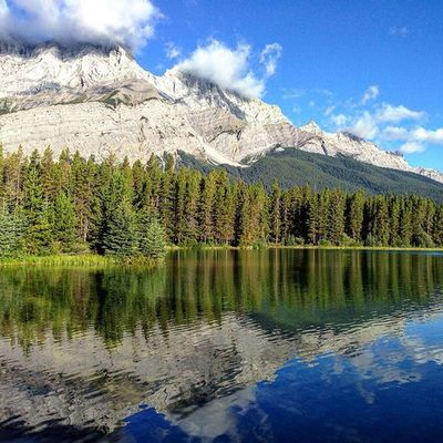 Clouds, mountains and lakes paint a perfect picture in the Canadianrockies at Banffnationalpark Nofilter needed for this morning shot at TwoJack Lakeside