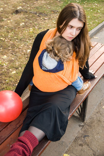 The holiday is over... Baby Baby Wrap Babywearing Balloon Bonding Childhood Children Contemplating Day Family Lifestyle Love Maternity Mom Mother And Son Motherhood Outdoors Parenting Perspective Portrait Real People Sitting Sleeping Sling Woman Live For The Story