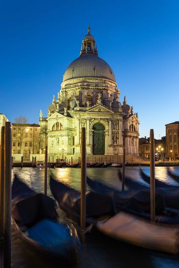 Basilica at night Spectacular Benatky Lagoon Venice Tourist Attraction  Gondolas Moving Venice Basilica Di Santa Maria Della Salute Attractions Canals Waterways Veneto Region Adriatic Sea Dome Building Exterior Built Structure Architecture Religion Travel Destinations Place Of Worship Spirituality Travel Tourism Building Outdoors