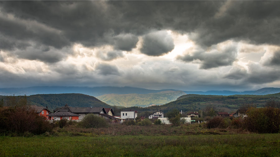 Scenic view of houses and buildings against sky