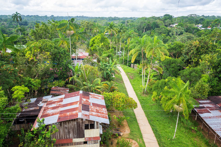 View of the town of Puerto Narino deep in the Amazon rain forest in Colombia Amazon Amazon Rainforest Amazon River Amazonas Colombia Day Foliage Green House Jungle Landscape Leticia Nature No People Outdoors Puerto Nariño Rain Forest Rainforest Sky South America Tourism Town Travel Travel Destinations Tree