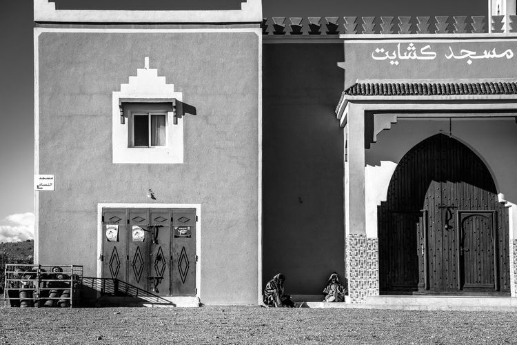 Moroccan scenery The Art Of Street Photography Architecture Built Structure Building Exterior Building Day No People Arch Window Nature City Religion Outdoors Sunlight Entrance Belief Place Of Worship Text Façade Wall - Building Feature