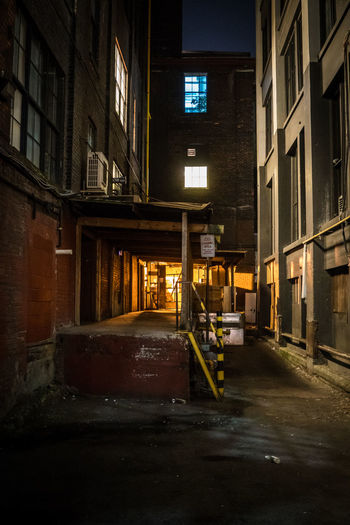 City Downtown Industrial Lights Queen West Alley Angles Architecture Building Building Exterior Buildings Built Structure City Corner Evening Illuminated Night No People Outdoors Street Windows Structures And Architecture The Architect - 2018 EyeEm Awards HUAWEI Photo Award: After Dark