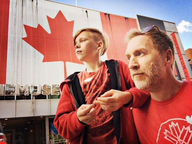 Canada Day, Father And Son Togetherness Real People Two People Lifestyles Red Day Young Adult Friendship Outdoors City People Adult Canada Flag