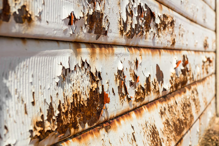 Rusty garage door. Vintage style. Ideal for backgrounds. Shallow depth of field. Abandoned Abstract Aging Aging Process Background Brown Corroded Corrosion Dirty Door Garage Grunge Grungy Heavy Industrial Industry Iron Metal Metallic Old Olden Pattern Peel Retro Roll