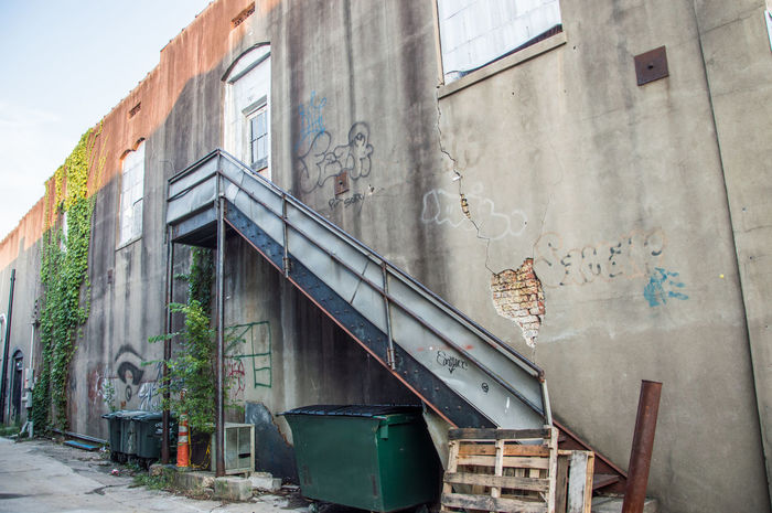 Abandoned Places Alley Architecture Building Exterior Built Structure Concrete Day Grafitti Grafitti Wall Industrial Low Angle View No People Outdoors Shadows & Lights Sky Stairway Street Photography Vines On Wall Window