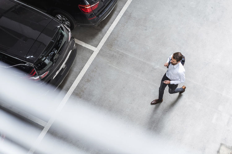 High angle view of man on car moving in city