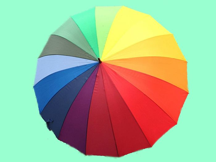 Multi Colored Protection Colored Background Umbrella Studio Shot Creativity Vibrant Color Close-up No People Green Color Red Paper Single Object Abstract Pattern Variation Blue Security Cut Out Personal Accessory