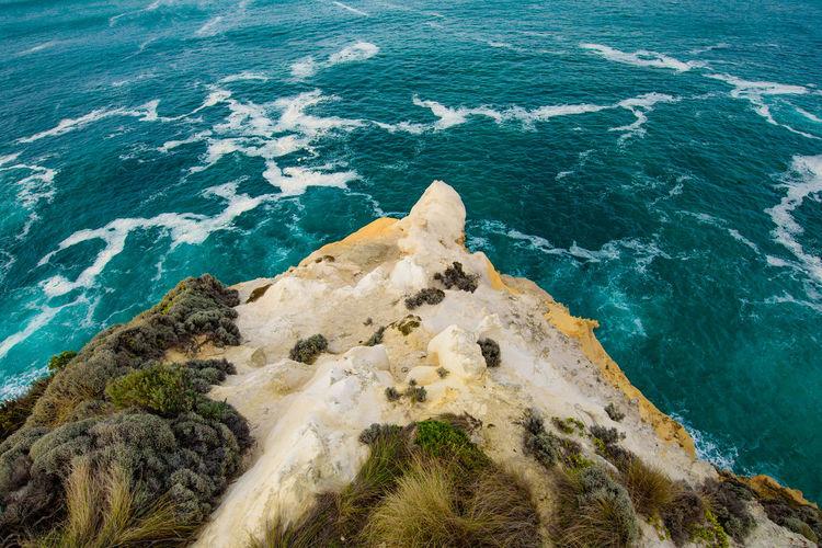 Aerial view of rocky coastline by sea
