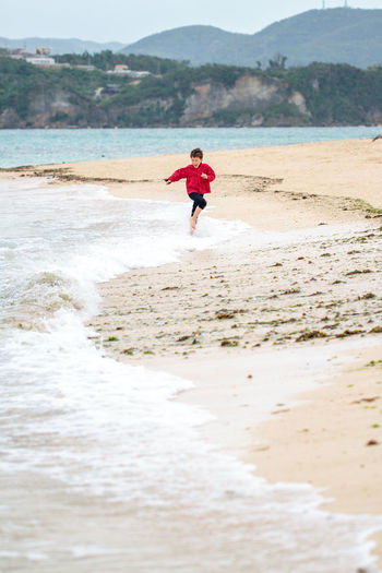 It's okay to get your feet wet. Beach Beach Photography Beauty In Nature Japan Kids Kids Being Kids Leisure Activity Nature Okinawa Running Shore Smile Vacation Water
