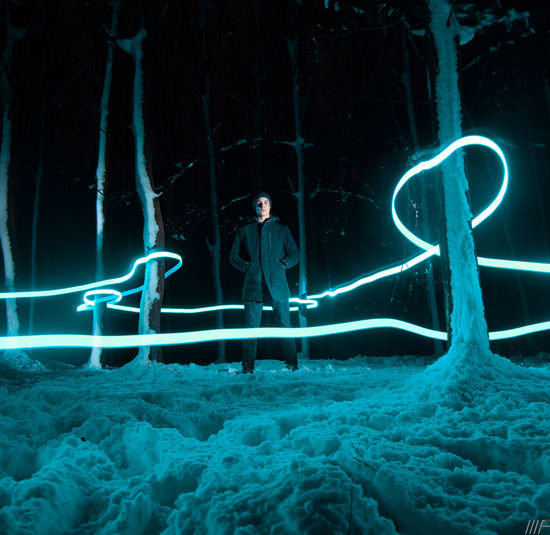 Illuminated Real People Motion Night Long Exposure Light Painting Lifestyles Glowing Leisure Activity Light Trail Nature People Water Men Standing Creativity Group Of People Women Blue Digital Composite