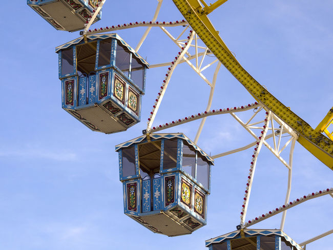 Amusement Park Amusement Park Ride Architecture Arts Culture And Entertainment Blue Building Exterior Built Structure Clear Sky Crane - Construction Machinery Day Ferris Wheel Low Angle View Machinery Metal Nature No People Outdoors Sky Tall - High