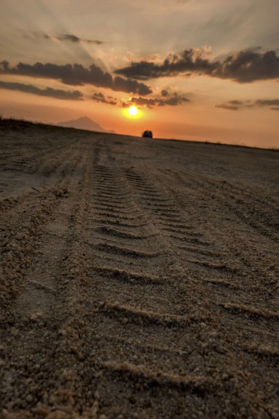 Driving to the Sun. Driving Sand Road To The Mountains Travel Travelling Trip Cloud - Sky Dawn Drive Landscape Scenics Sunrise Sunset To The Sun Trace Traces Traces In The Sand Tranquil Scene Tranquility Tyre Trace Tyre Traces Wheeling
