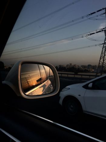 Car Motor Vehicle Sky Transportation Glass - Material Mode Of Transportation Land Vehicle No People Sunset Nature Car Interior Reflection Transparent City Vehicle Interior Side-view Mirror Travel Architecture Dusk Road