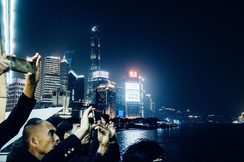 Taking pictures... Shanghai, China City Life Nightphotography Cityscape Illuminated City Night Architecture Group Of People Water Building Exterior Built Structure Real People Photographing Men People Photography Themes Sky Activity Adult Lifestyles Smart Phone