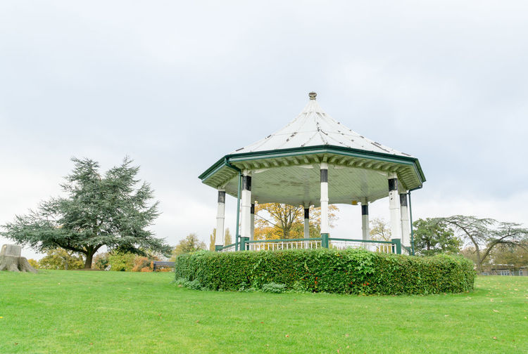 Gazebo on field against sky