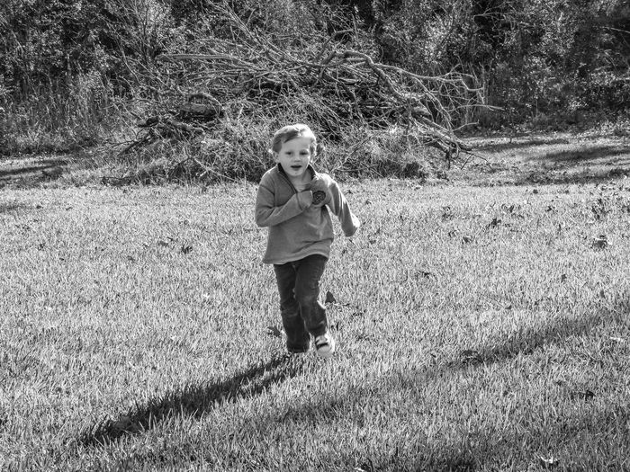 Day One Person Shadow Real People Outdoors People Boy Running Playing Running Shadow People Monochrome Black And White Photography Happiness Smiling Face Action Shot  Motion People In Motion People In Action Stopped In Motion Running Towards Black And White Childhood Child Child Playing Playing Chase Black And White Friday EyeEm Ready   A New Beginning