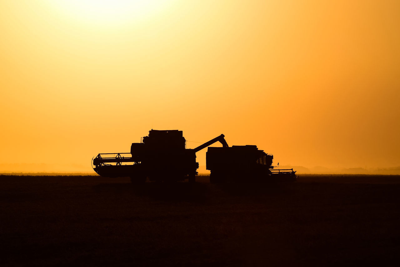 sunset, orange color, silhouette, field, nature, outdoors, sky, no people, beauty in nature, clear sky, drilling rig