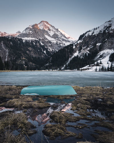 Alpenglow reflection at the Lauenensee in the Bernese Oberland. Beauty In Nature Blue Cold Cold Temperature Day Frozen Ice Lake Landscape Lauenensee Melting Mountain Mountain Range Nature No People Outdoors Physical Geography Scenics Sky Snow Snowcapped Mountain Tranquil Scene Tranquility Water Winter