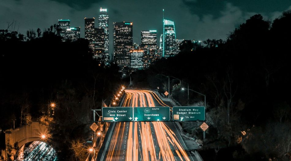the city is always alive Tones Clouds Light Trail Bright Car Traffic Nightphotography Los Angeles, California Light Illuminated Night Architecture Outdoors No People Building Exterior City Cityscape Sky First Eyeem Photo