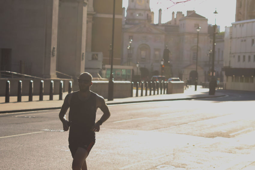 Running your life away. Taken on the streets of London. Crazy how people really do risk their lives when running and cycling. Exercise Exercising Marathon Perspective Run Running Architecture Building Exterior City Exposure Lifestyles Movement Movement Photography One Person Street Streetphotography Sun Transportation Summer Sports