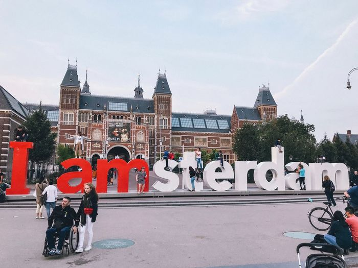 Iamsterdam Built Structure Architecture Building Exterior Transportation City Group Of People Mode Of Transportation Men Real People Bicycle Building Day Street People Nature Sky Road Land Vehicle Lifestyles Women Outdoors EyeEm Best Shots EyeEmNewHere EyeEm Nature Lover