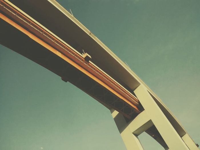 Low angle view of railroad bridge against clear sky