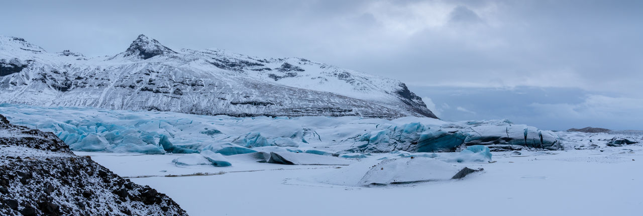 Panoramic image of the snow-coverd glacier Svinafellsjoekull on a winter day after snowfall, Iceland, Europe Cold Temperature Winter Snow Beauty In Nature Scenics - Nature Tranquil Scene Tranquility Environment Frozen Snowcapped Mountain Ice Landscape Sky No People Nature Svinafellsjoekull Iceland Tranquility Travel Destinations Travel Tourism Tourist Attraction  Nature Scenery Scenics Glacier Mountain Range Panorama Panoramic Climate Change Global Warming Melting Glacier