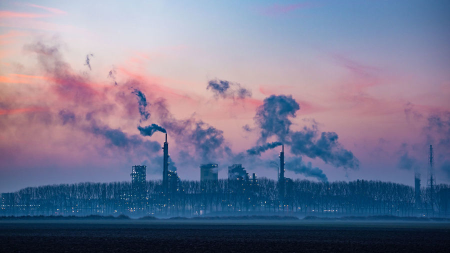 Industrial landscape Blue Hour Business Cloud - Sky Copy Space Dirt Dusk Environment Factory Fuel And Power Generation Full Frame Fumes Industry Nature Nature No People Outdoors Pink Pollution Sky Smog Smoke Social Issues Sunset Technology Zeeland  Millennial Pink